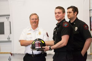 Left to Right: Deputy Chief Mike Holzmueller, Engineer Nicholas Pierson,  Background Captain Sam Sanders